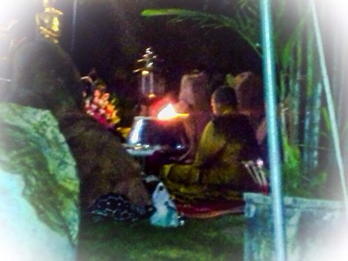 Kroo Ba Krissana Intawano blessing amulets inside a cave