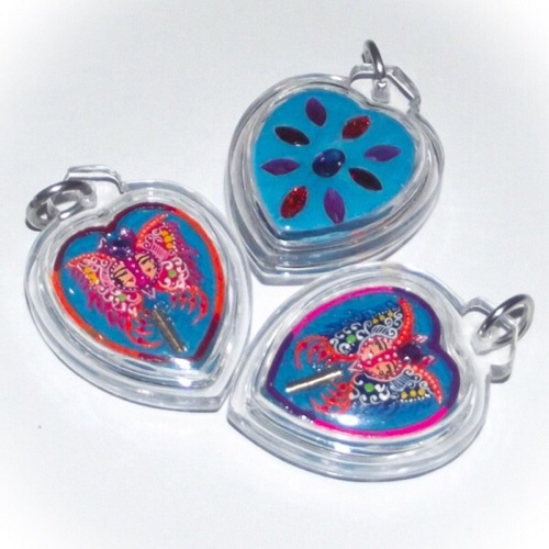 Taep Jamlaeng Butterfly King Amulet blue powders hand pajnted heart shaped amulets with Ploi Sek Maha Pokasap - from Kroo Ba Krissana Intawano