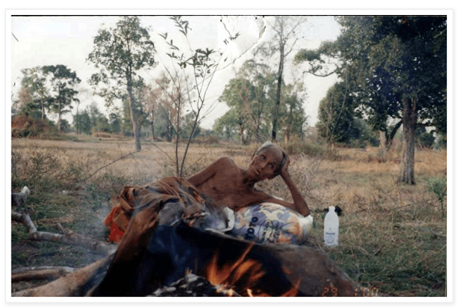 Luang Phor Suang in one of the fields he would sleep in, burning his possessions.